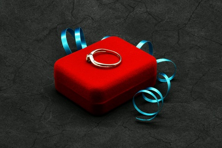 gold: Gold ring on red jewelry box