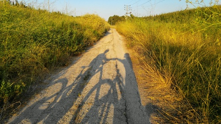 Shadows of a man and a woman with bicycles Stock Photo