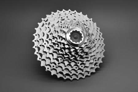 Mountain bike rear cassette on a gray background.