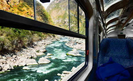 View of Urubamba river from train window. Stock Photo