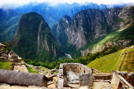 Inca city Machu Picchu in Peru. Ancient lost city in mountains.