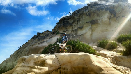 mountain biker: Mountain biker admires the views from a mountain