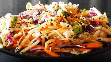 Healthy asian salad with root vegetables in asian restaurant. Stock Photo