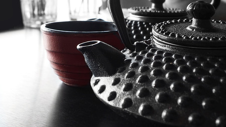 Japanese cast iron tea kettles with tea and japanese tea cup.