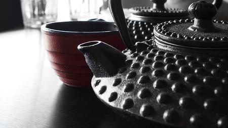kettles: Japanese cast iron tea kettles with tea and japanese tea cup.