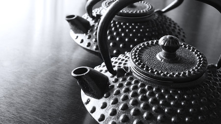 Two black Japanese cast iron tea kettles