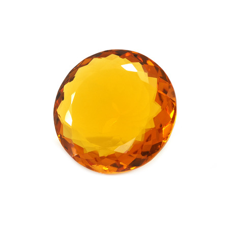 Round shaped orange gemstone on a white background.