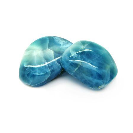 Rare gemstone - larimar or blue pectolite. White background. Archivio Fotografico - 129566460
