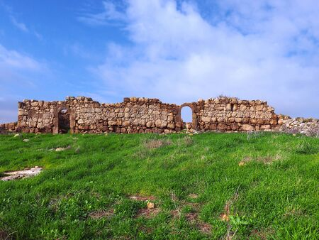 The ruins of an ancient hilltop village. Ancient Israeli place Ramat Avisur in the winter. Фото со стока