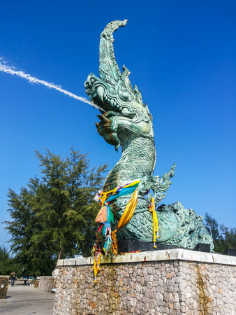 serpents: The serpent blow water and blue sky on daylight Stock Photo