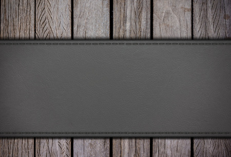 leatherette: Leatherette on old wood backgrounds