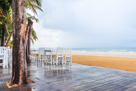 wood floor and seaside table with beach and sea background after raining Stock Photo