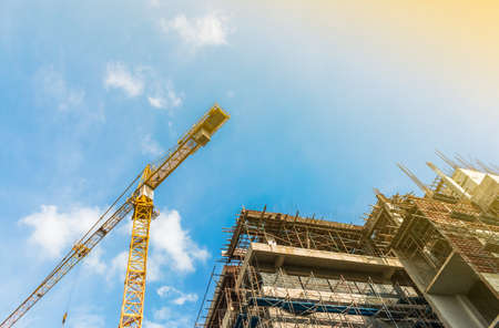 construction site and crane with blue sky and sunlight Standard-Bild - 157141931