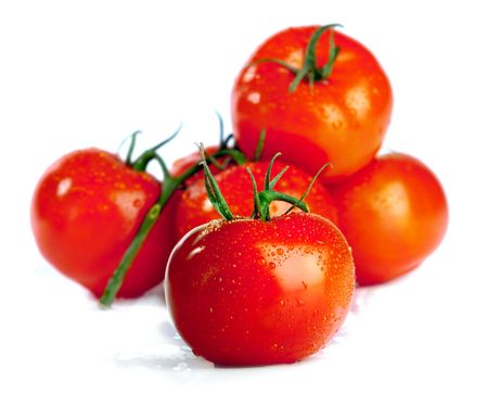 tomatoes isolated over a white background photo