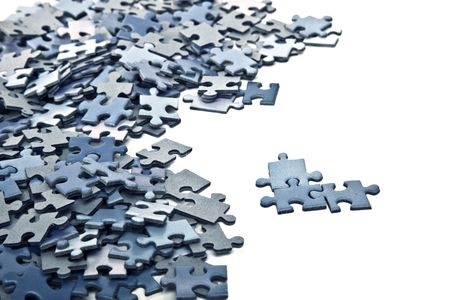 elements of a blue puzzle isolated over a white background Standard-Bild