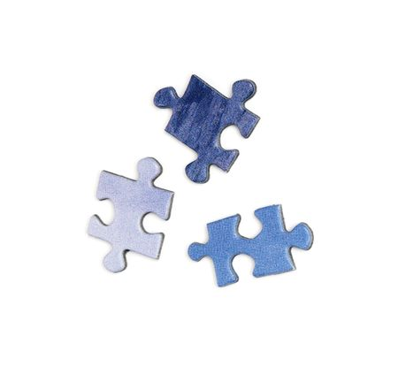 three blue colored elements of puzzle isolated over a white background photo