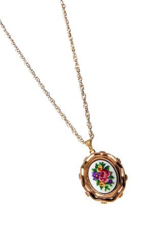 frippery: retro pendant on a gold chain isolated over a white background