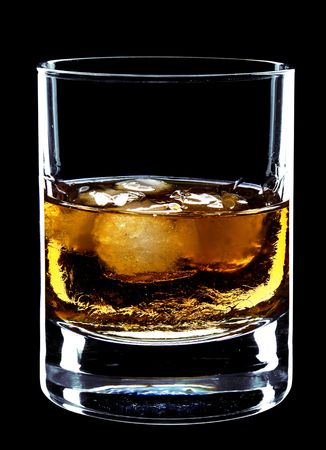glass of whiskey and ice isolated over a black background photo