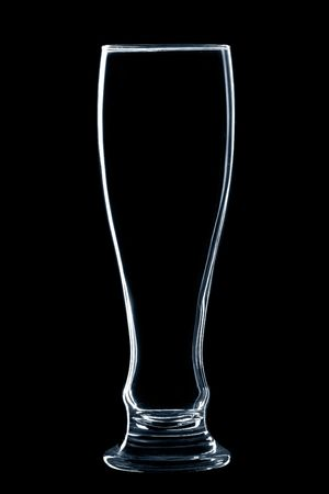 empty glass of beer isolated over black background photo