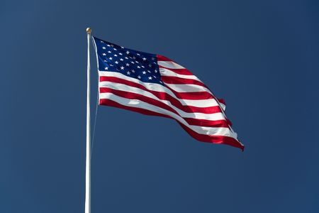 wave crest: American Flag on the blue sky Stock Photo