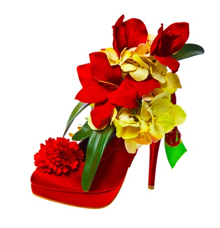 ladys shoe decorated with flowers, isolated over white background photo