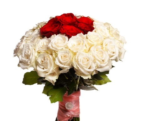 wedding bouquet of red and white roses, decorated with ribbon and brooch. Isolated on a white background. photo