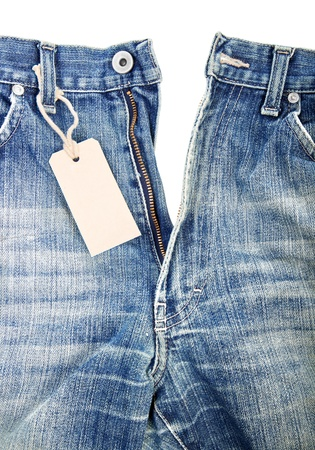 unbuttoned blue jeans with paper label photo