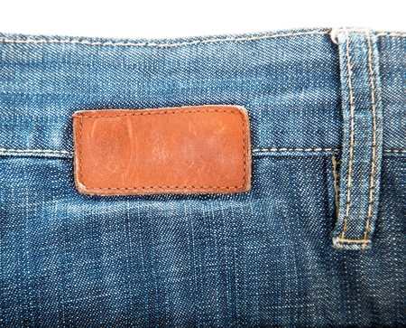 blank leather label sewed on blue jeans photo