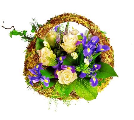 isolated irises: basket of roses, iris dutch xiphium, and veronica Stock Photo