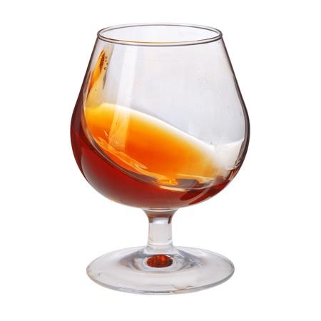 Splash of Cognac im Glas auf weißem Hintergrund Standard-Bild - 19023126