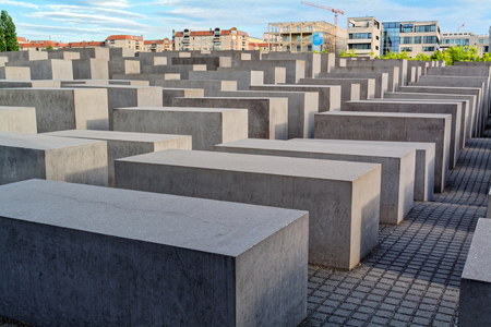 holocaust: Berlin, Germany - may 31, 2015: Holocaust Memorial (Monument to the Murdered Jews in Europe. Occupying about 19,000 square meters of space near the Brandenburg Gate, the Berlin Holocaust Memorial is made up of 2,711 concrete slabs without markings.