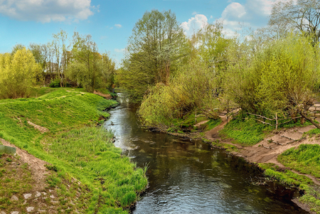 tributary: Panke river, a right tributary of the Spree, in Pankow, Berlin, Germany in the springtime. Stock Photo