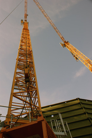 Cranes while demolition of gas tank photo
