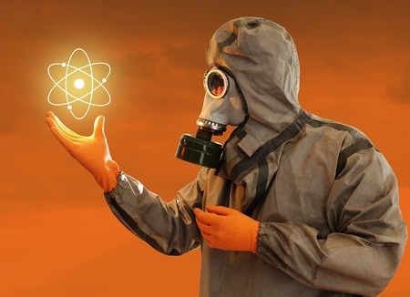 Man In Protective Costume With The Shining Nuclear Power Symbol Stock Photo - 11185406