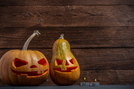Two decorated pumpkins for a Halloween on a mystical autumn background with candles Stock Photo