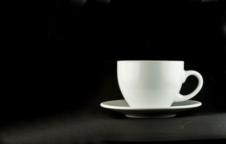 Perfect white coffee cup on a black background photo