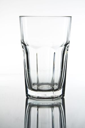 half full: Glass on white background with reflection. Stock Photo