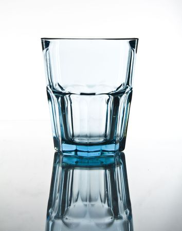 blue glass on white background with reflection photo