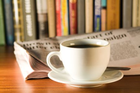 Coffee and books on a wooden table. Small depth of sharpness. Stock Photo