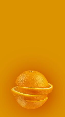 Orange sliced on a bright orange background. Minimum fruit concept. Format 9-16