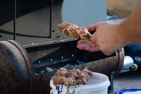 skewers on skewers.Roasted meat cooked at barbecue.BBQ fresh beef meat chop slices. Traditional eastern dish, shish kebab. Grill on charcoal and flame, picnic, street food.Barbecue skewers meat kebabs Stock Photo