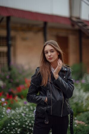 Beautiful young girl on a background of blooming flowers.Woman and flowers Stock fotó