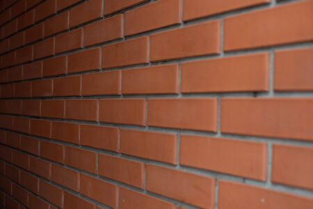 Brick wall background. Red brick. Tiled Red Brick Wall. Brick wall background. The red brick is shot in daylight after rain. brick texture for designers. Building, brick, background.Construction