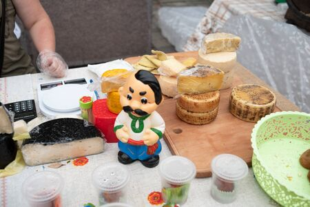 Various fast food. Festival of Street Food, Oktoberfest. Street Food Cheeses. Varieties of cheeses from the manufacturer. Craft types of cheese. Goat and cow cheese. Healthy food with dairy products Stock Photo
