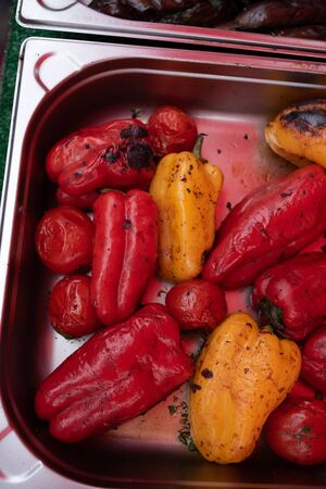 Bulgarian sweet salad red pepper grilled. Red sweet pepper baked on the grill. Street food. Street Food Festival. Grilled vegetables on the fire. Healthy food. Vegetarianism or Vegetation.