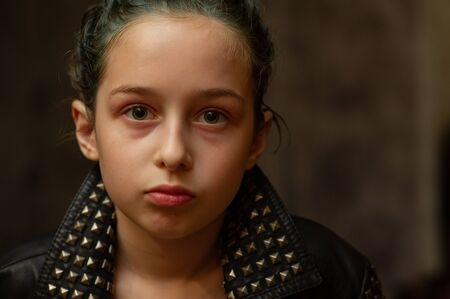 Portrait of nine year old girl. Teenager with blue strands on her hair. A series of photos of a girl of 8 or 9 years old. A teenage girl in a leather jacket. A teenager with collected hair in a bun.