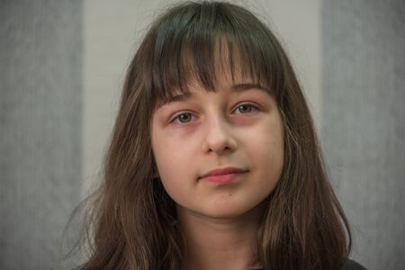 portrait of a little girl. Girl 9 years old. Girl after cutting bangs in a beauty salon. Portrait of a teenager.