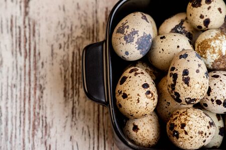 quail eggs in a wooden board. Quail eggs. Healthy nutrition, food photography. Happy easter. Organic products. Raw quail eggs