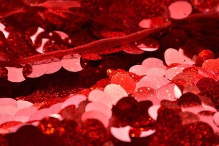 Red sequins pattern. Sparkling sequins background. Red sequin fabric for background. rectangular red shiny fabric with sequins, Christmas background. Sequins on Fabric, red Beads. Fashion Fabric
