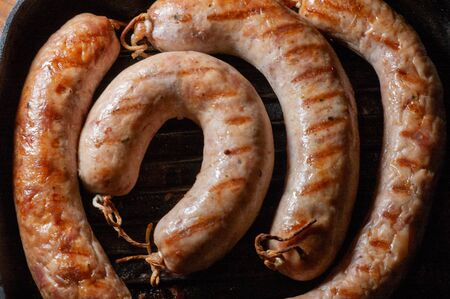 Fresh sausage on a barbecue grill. Grilled sausage. Meat dish food photography